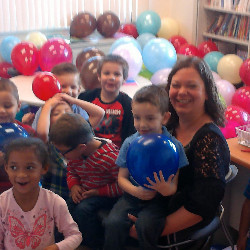 picture of principal and students with balloons