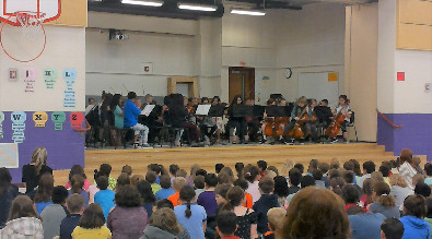 orchestra students playing in front of an audience