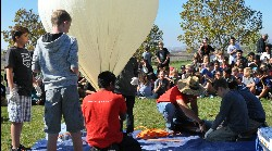 Students observing a balloon.