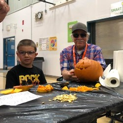 Boy and Old man carving pumpkin
