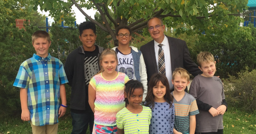 Picture of school principal Brent Young and a few Alta Vista students.