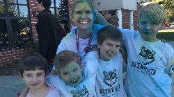 Picture of principal and 4 boys covered with color dust.