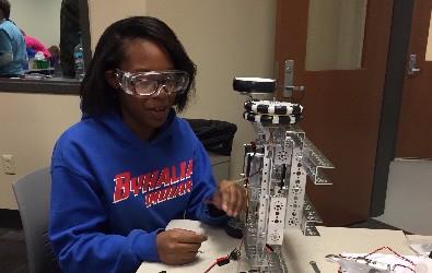 robotics team member working on a robot