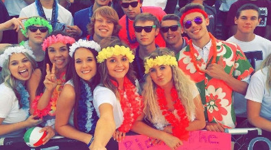 "Photo of fans at the East vs. Natrona ""Beach/Hawaiian"" football game."