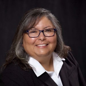Dr. Alma Charles