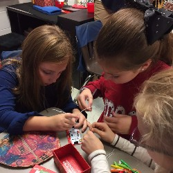 Students engaged in creating and making in a Makerspace.