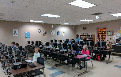 front view of students coding