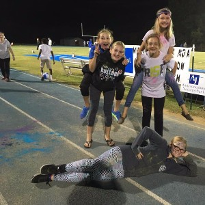 Students acting silly at football game