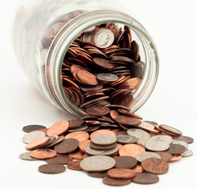 Photo of a jar filled with pennies.