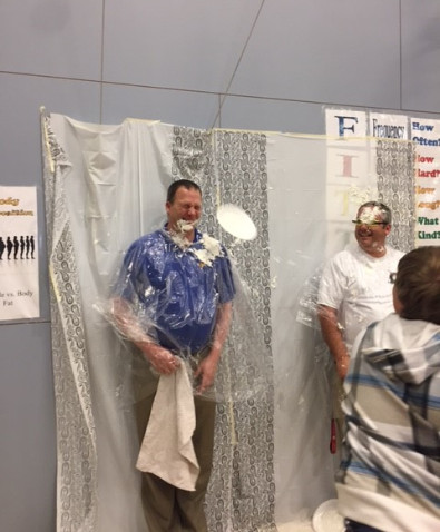 Picture of Mr. Schlagel and Mr. Brinkman getting pied in the face.