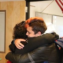 Mom hugs son after Disco Graduation Ceremony