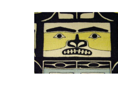 photo of a face on a Chilkat Robe