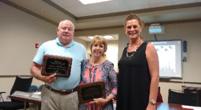 SCHOOL BOARD HONORS RETIRING ADMINISTRATORS