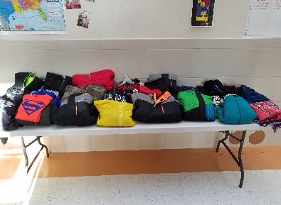 Table of lost and found clothing items