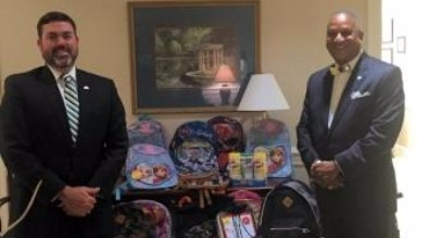 Solicitor's office delivers school supplies to District 55 and 56