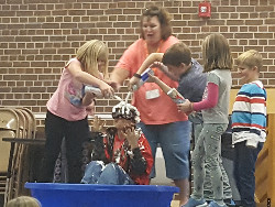Students pouring liquid on the principal.