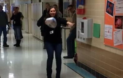 The principal getting ready to throw a strike.