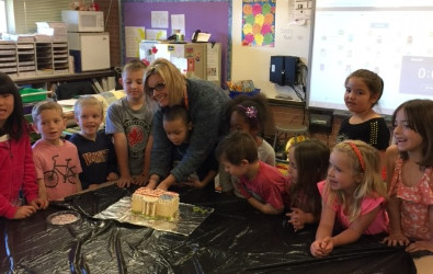 Students building a White House made of treats.