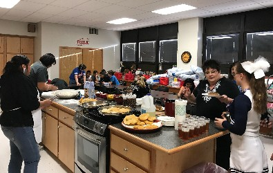 Mrs. Hall serving up indian tacos.