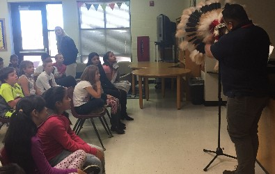 Students at Roblyer learning about the Headdress.