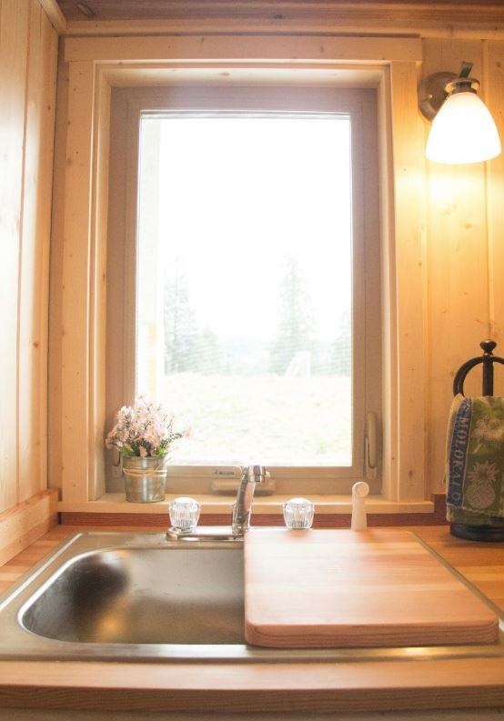 KITCHEN WINDOW ABOVE STAINLESS SINK