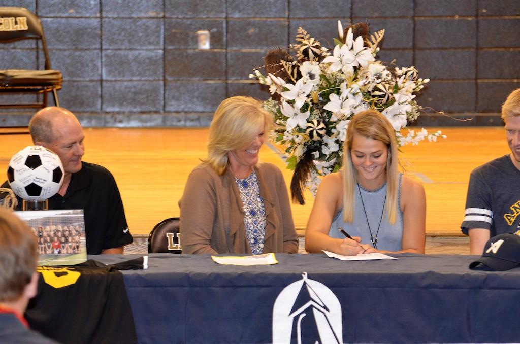 Courtney Edwards signs Athletic Scholarship