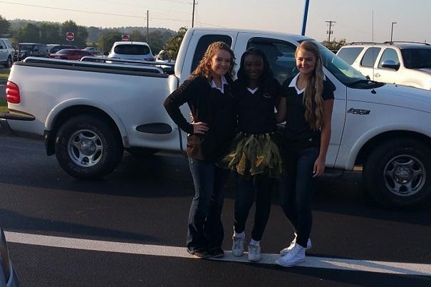 Cheerleader greets Elementary Car-Riders