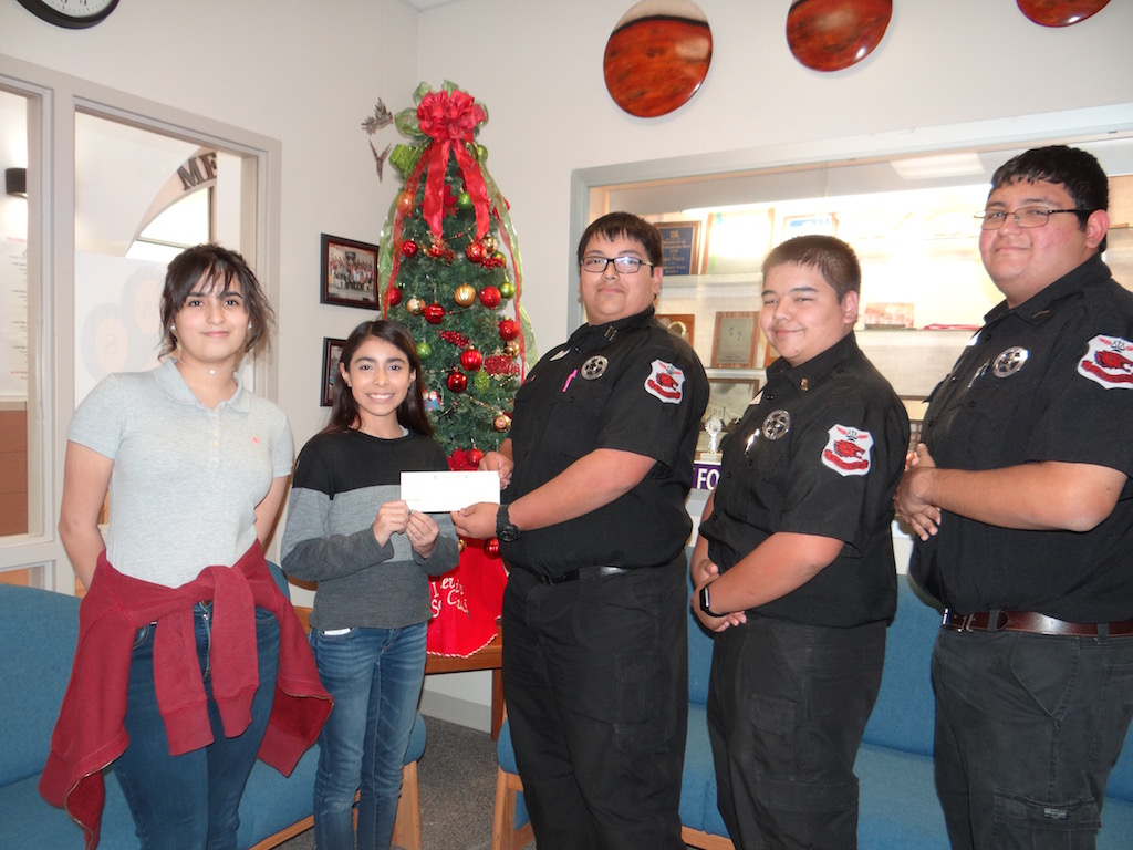 WAMS presents check to AHS Jr. Police Academy Toy Drive in the amount of $600.00