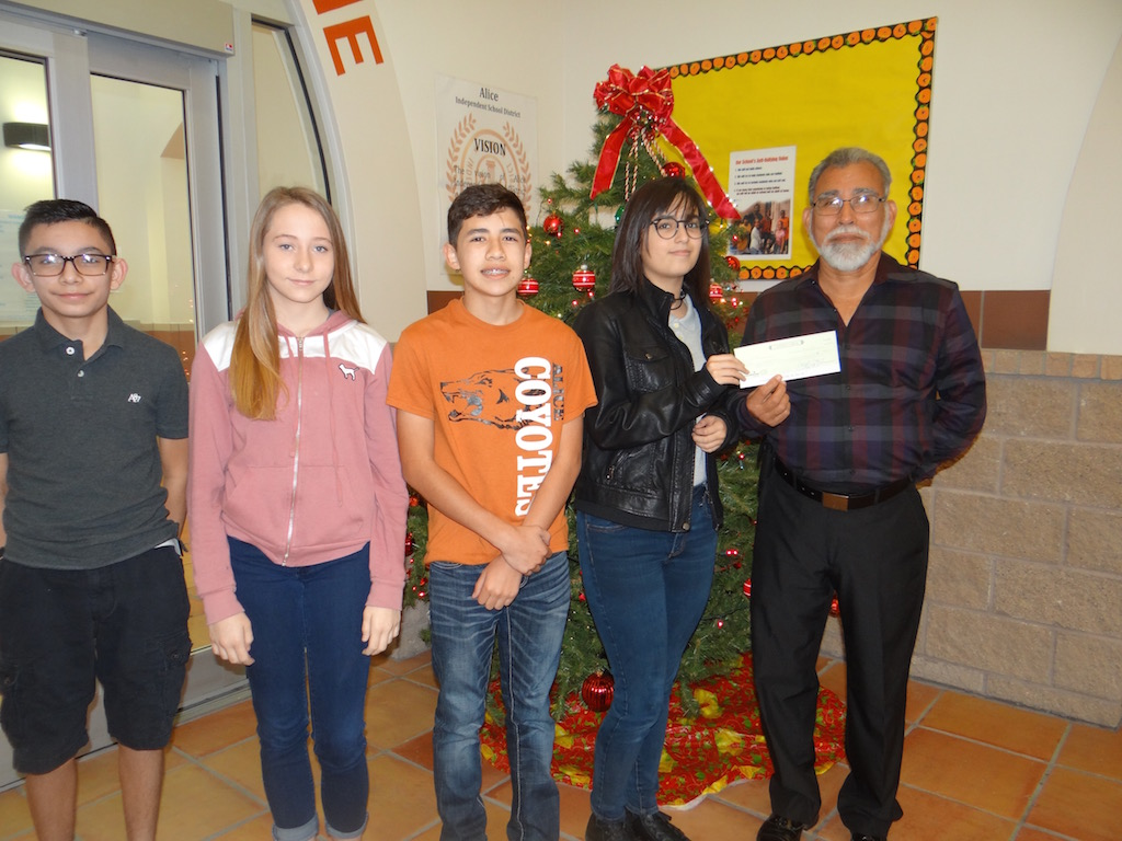 WAMS presented a check to the Alice Food Pantry.