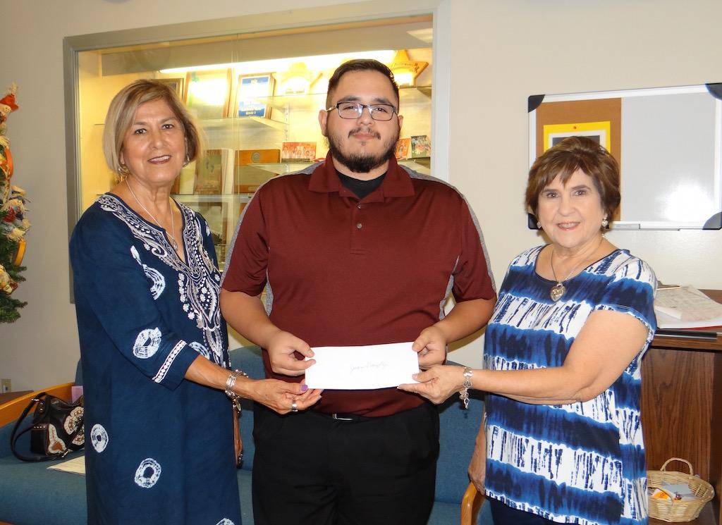 Juan Gonzalez receiving a grant from the Tri-County Texas Retired Teacher Assoc.