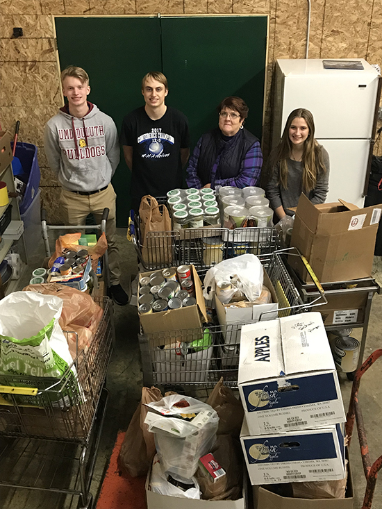 WE Scare Hunger 2018 - From left: Tom Hanson. Ethan Anderson, Walker Area Food Shelf Representative and Alexa Kennedy