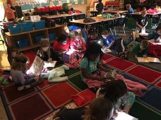 Primary PBIS reading with Flashlights
