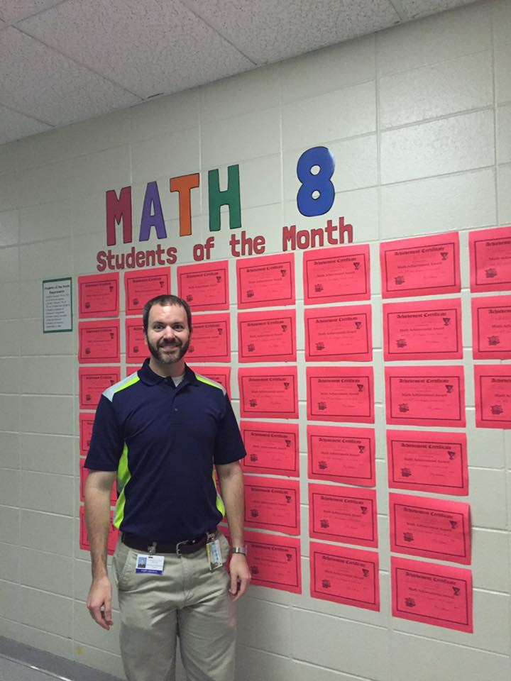 Mr. Coleman with Student of the Month Certificates in Math